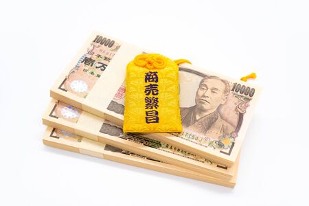 Amulet of prosperous Japanese business on a white background