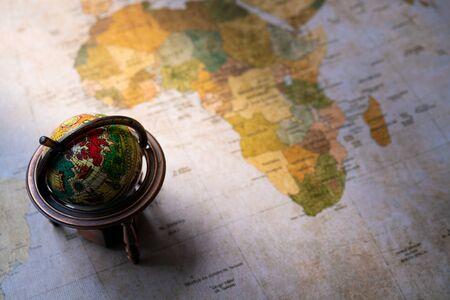 A small globe on a world map