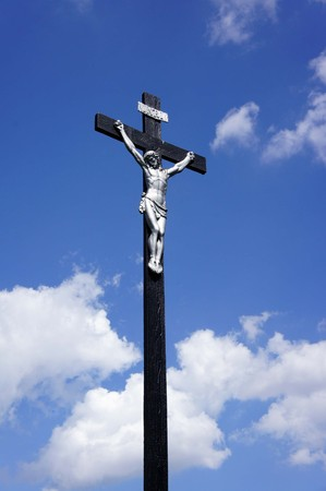 inri: Jesus on the cross against a blue sky