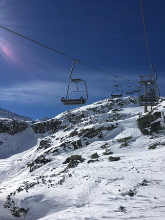 Ski lift, sunny day in the mountains