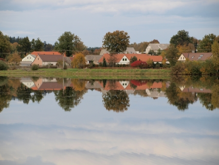 mirroring: Mirroring the village on a pond  South Bohemia
