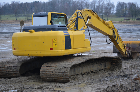poke: excavator regulates the lake bottom South Bohemia Czech Republic