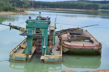 sand quarry: mining of sand, bucket boat in the sand quarry Cep II, South Bohemia, Czech Republic