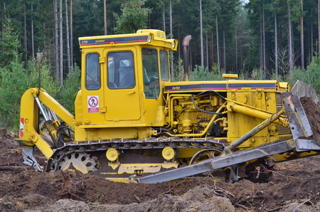 bohemia: bulldozer at work in the woods, south Bohemia, Czech Republic