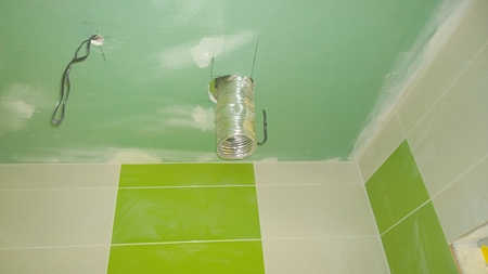Construction work in the apartment, installation of tiles on the wall and plaster ceiling, Czech Republic Stock Photo