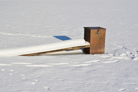 equipment for draining water from the lakes frozen in ice, south Bohemia, Czech Republic