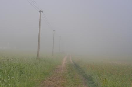 Spring misty path in the countryside of South Bohemia, Czech Republic Reklamní fotografie - 103896677