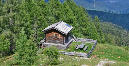 old wooden house, Gailtal Alps, view from the hiking trail on the mountain Dobratsch, Carinthia, Austria