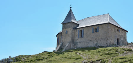 The church of Maria am Stein, the mountain Dobratsch (or Villacher Alpe, 2166 m above sea level) in the Austrian state of Carinthia. It forms the eastern tip of the Gailtal Alps and is located to the west of Villach. Austria
