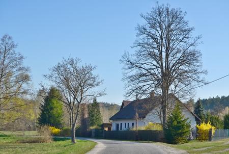 house in spring landscape, southern Bohemia . Czech Republic