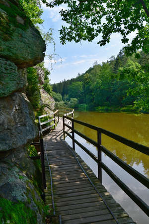 wooden footbridge over the water on a hiking trail along the river Luznice, southern Bohemia, Czech Republic