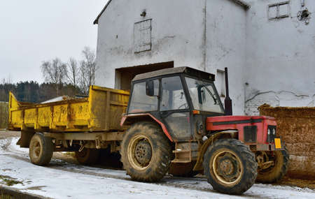 old tractor with a trailer for manure collection, South Bohemia, Czech Republic