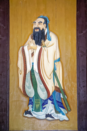 Close up view of Confucious painting on the wall Redakční