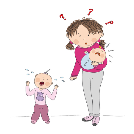 Young mother holding little crying baby girl, her second child, Little toddler is standing, screaming, having temper tantrum.