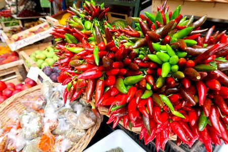 Chillies, red chilli pepper, on the traditional italian fruit, vegetable and spice market in Gallipoli town, Italy, Apulia region, Adriatic Sea Фото со стока