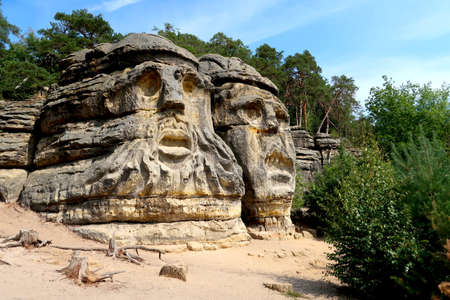 Devil's Head (Certovy Hlavy), two faces carved in sandstone rocks, Kokorin Forest, Village Zelizy, Czech Republic