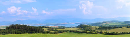 Liptov panorama with Low Tatras (Nizke Tatry) and Liptovkska Mara water lake reservoir in the background. Summertime in the Northern Slovakia, Slovak Republic, Europe. Stockfoto