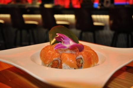 Salmon sushi roll japanese restaurant with chopped salmon