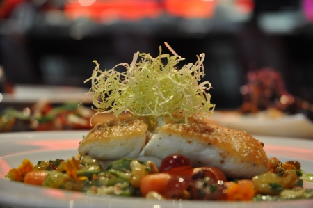 entree: Chilean Sea Bass fish dinner entree with vegetables plated fish meal  gourmet Stock Photo