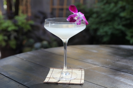 lychee martini outside with flower specialty cocktail drink tropical hawaiian beverage