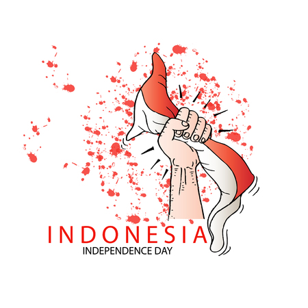 Hand holding a red and white Indonesian flag.  Independence day celebration of indonesia