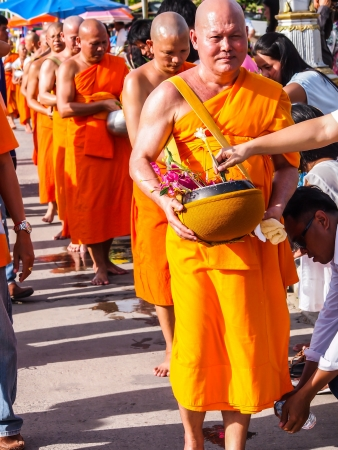 Tak Bat Dok Mai, Flower Offering Ceremony in Saraburi, Thailand