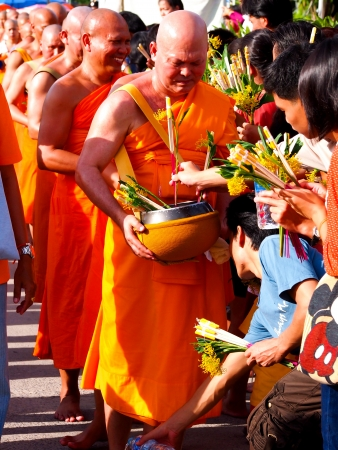 folkways: Tak Bat Dok Mai, Flower Offering Ceremony in Saraburi, Thailand