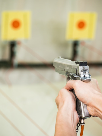 Man shooting with air gun on practicng target photo