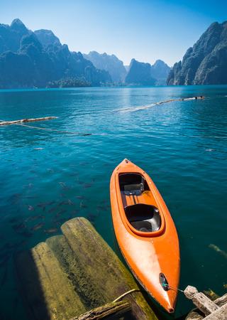 skiff: Floating Orange Canoe in Rajjaprapha Dam