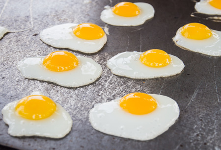 epicurean: Fried Quail Eggs Cooking On Frying Pan, Thai Style Snack