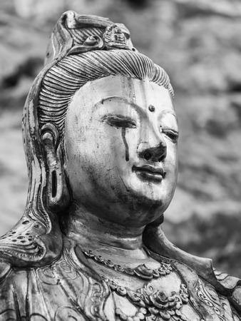 Monochrome crying  goddess of mercy statue  Quan Yin, Kuan Yim, Kuan Yin , Thailand photo