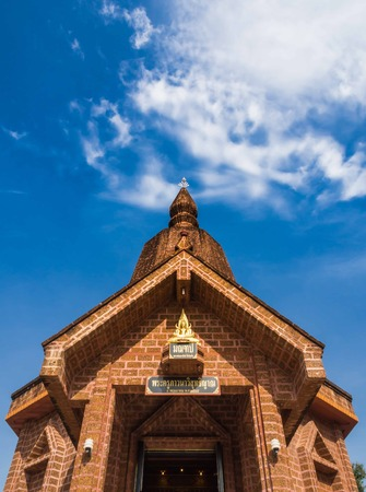 Buddhist temple made of Laterite with clear blue sky photo