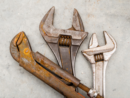 Rusty grunge wrench and spanner for maintenance engineer photo