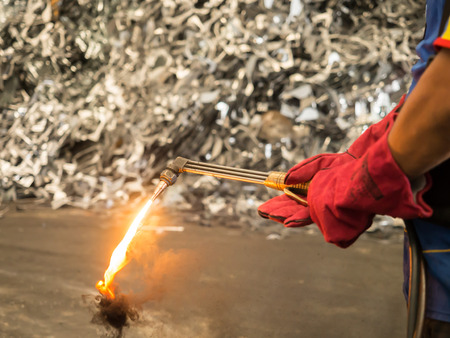 soot: Metal cutting torch with soot and flame in recycle factory