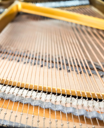 classical mechanics: Closeup strings and pins inside classical piano Stock Photo