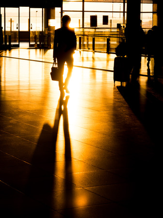 businessman waiting call: Silhouette traveling businessman in international airport preparing for departure Stock Photo