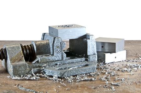 Vice with cuttings and aluminium blocks photo