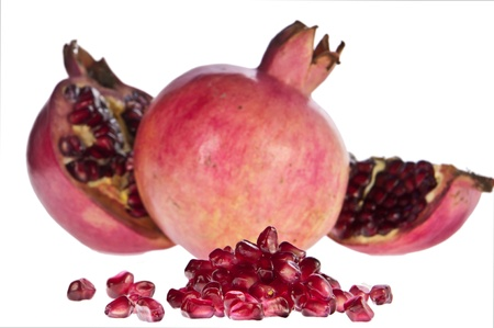 punica granatum: Pomegranates with seeds in front Stock Photo
