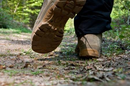 hiking boot: Closeup while walking Stock Photo