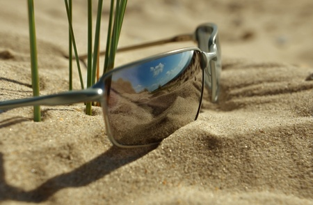 Sunglasses in the sand photo