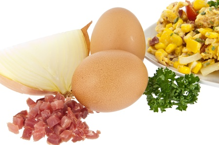 Scrambled eggs on a plate with raw ingredients isolated on white background  photo