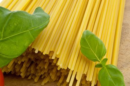 Spaghetti with basil and tomato photo