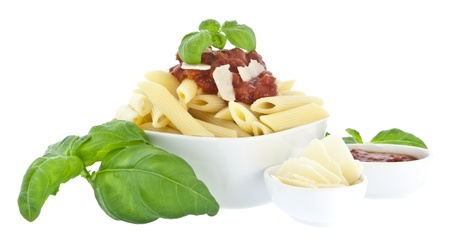 chese: Penne in a bowl isolated on white background with tomatoe sauce and fresh chese Stock Photo