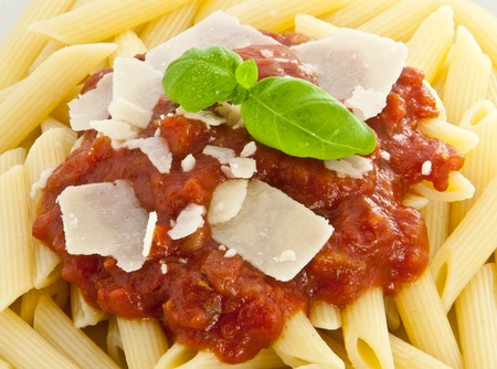 chese: Penne with sauce, fresh basil and chese Stock Photo