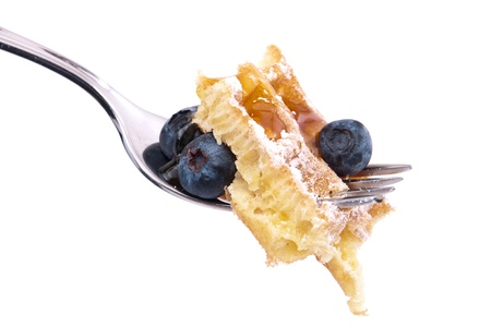 Fresh homemade waffle with powder sugar and berries on a fork Stock Photo - 13255144