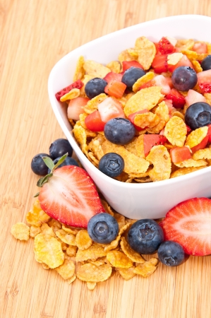 Heap of Cornflakes with fruits (Strawberries and Blueberries) in a bowl Stock Photo - 13709527