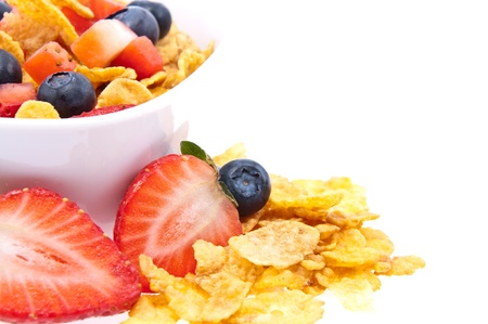 Cornflakes with fresh fruits in a bowl isolated on white background Stock Photo - 13699380