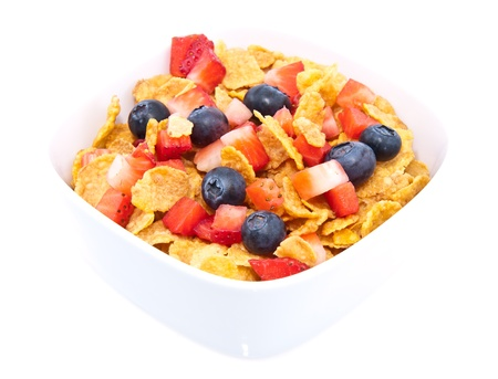 Cornflakes with fresh fruits in a bowl isolated on white background Stock Photo - 13699375