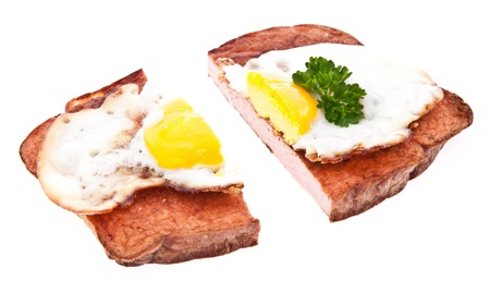 Halved meat loaf with fried egg isolated on white background Stock Photo - 13778888