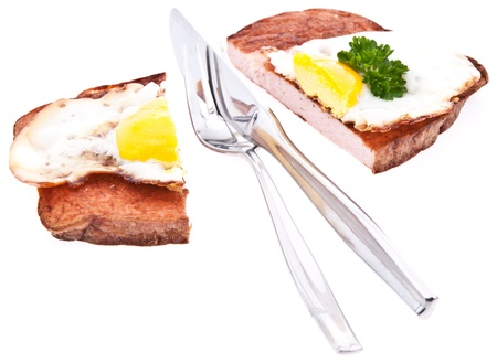 Halved meat loaf with fried egg isolated on white background Stock Photo - 13778882